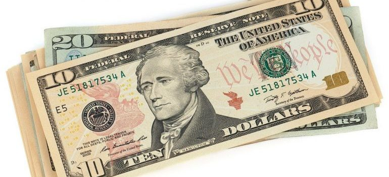 Dollar bills to save after moving off-grid.