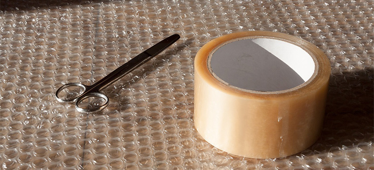 bubble wrap, a pair of scissors and a ducktape