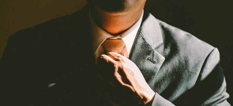 A man fixing his tie.