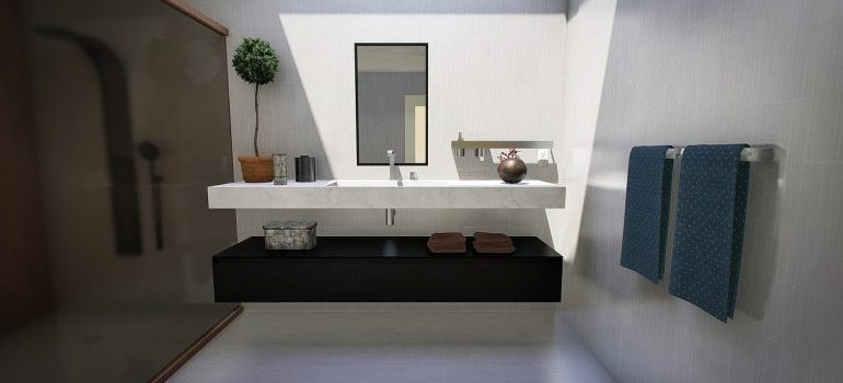 Minimalistic bathroom to use after simplifying your home after moving.
