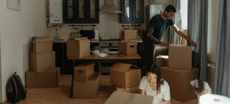 man and woman packing their kitchen