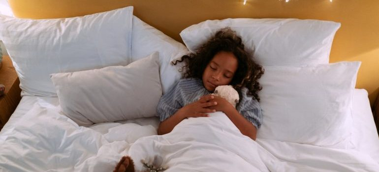A girl sleeping in bed.