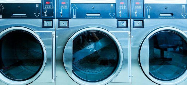 a trio of washing machines