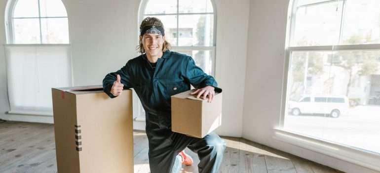 Man packing for moving from Everett to Seattle
