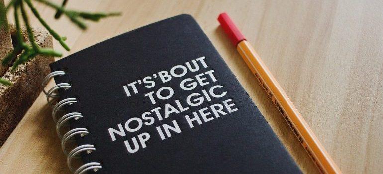 A pen next to a notebook.