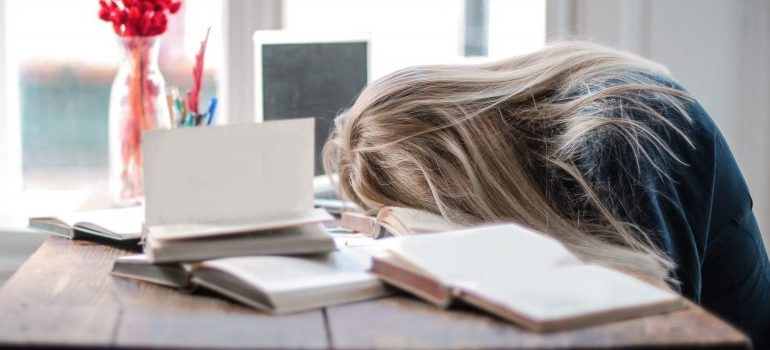 woman falling asleep at a desk