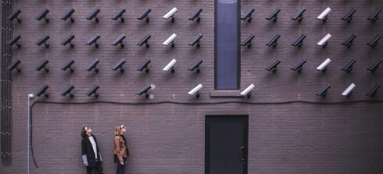 A wall of security cameras