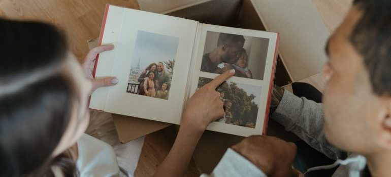 people looking at a family album