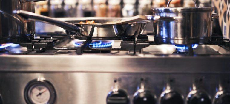 A metal pan over a gas stove