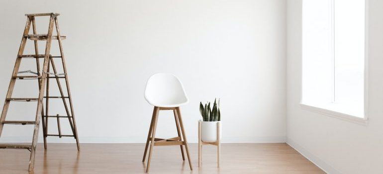 A ladder and a chair in a room