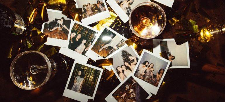 Polaroid photos among wine glasses