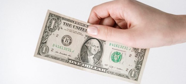 person holding a $1 bill