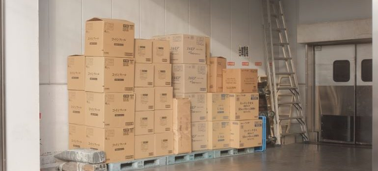 Stacked pile of moving boxes.