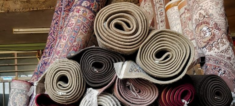 rolled-up rugs and carpets