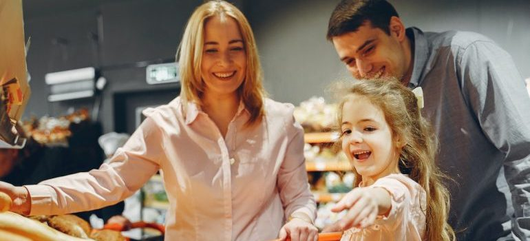 Parents with a kid in a grocery store.