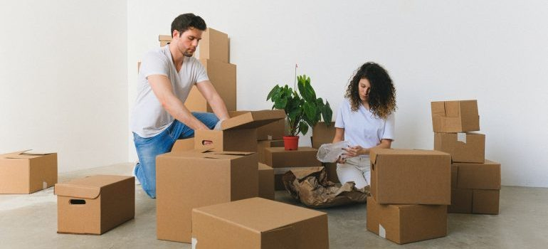 Couple packing and moving dining room