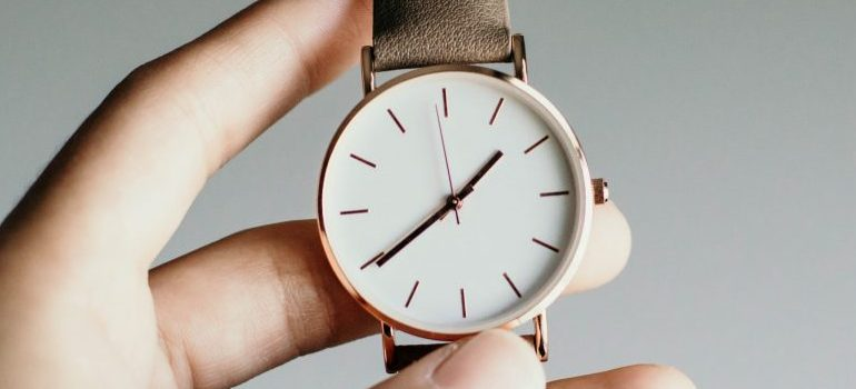 person holding a wrist watch