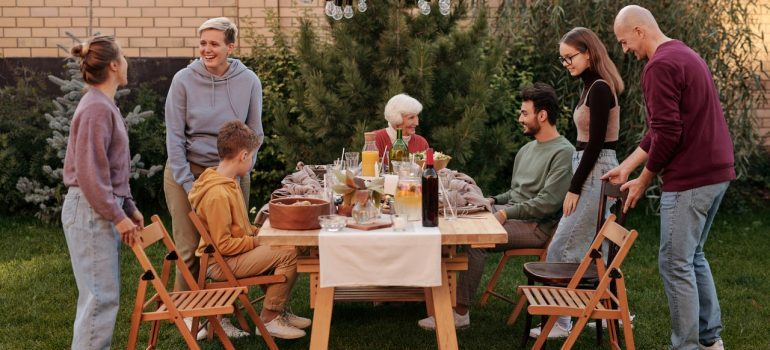 Family and friends eating in a backyard